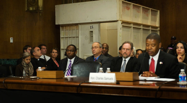 Panel-w-Dir.-of-FBOP-Charles-Samuels-Jr.-at-mic-mock-solitary-cell-by-ACLU-at-Senate-hearing-061912-by-Jonathan-Ernst, California leaders call on Gov. Brown to grant demands of prisoners in solitary confinement, Behind Enemy Lines
