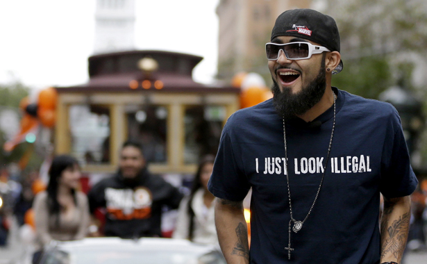 SF-Giants-pitcher-Sergio-Romo-t-shirt-GÇÿI-just-look-illegalGÇÖ-World-Series-victory-parade-103112-by-Marcio-Jose-Sanchez-AP, The 2012 election heralded by Sergio Romo's shirt, Culture Currents