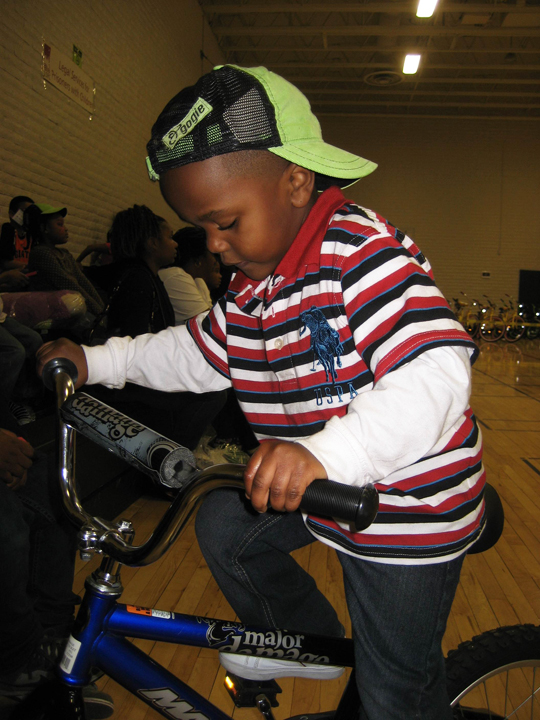 All-of-Us-or-None-13th-Annual-Community-Giveback-Jerimiah-Turner-4-rides-1st-bike-120812, Children receive gifts from loved ones behind bars at Community Giveback, Local News & Views