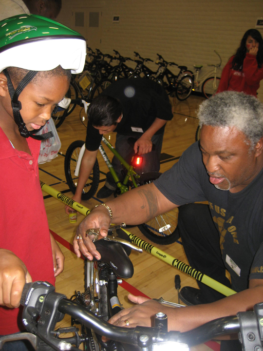 All of Us or None 13th Annual Community Giveback Jerry Elster adjusts bike 120812