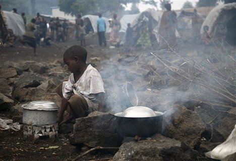 Child-heats-water-in-Mugunga-Camp-outside-Goma-112412-by-Jerome-Delay-AP, Six million dead since 1996? It's time to break the silence on the Congo War, World News & Views