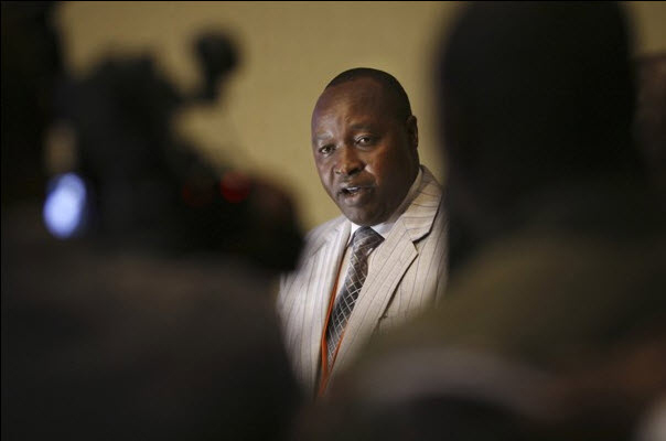 M23 delegation leader Francois Rucogoza sits down for peace talks with the DRC delegation headed by Congolese Foreign Minister Raymond Tshibanda in Kampala, Uganda. – Photo: Rebecca Vassie, AP