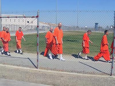 North Kern State Prison prisoners walk along fence line