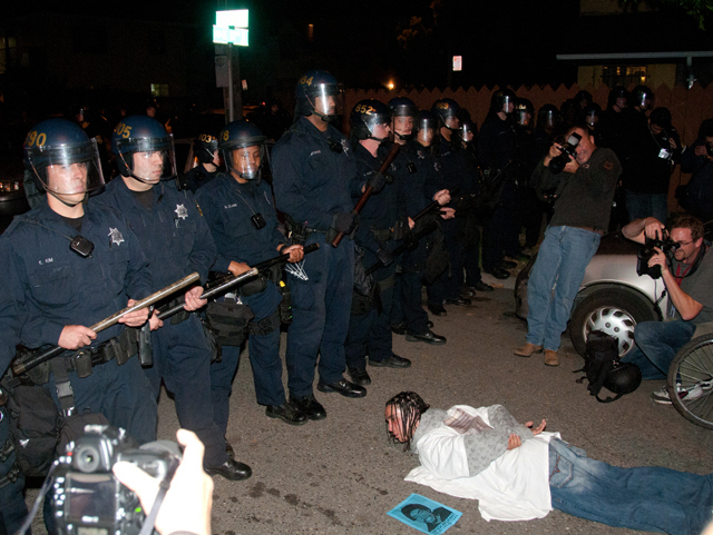 OG-Mehserle-sentencing-cops-face-protester-in-I-am-Oscar-Grant-position-110510-by-Felix-Barrett, Supreme Court rules cops can be filmed, National News & Views