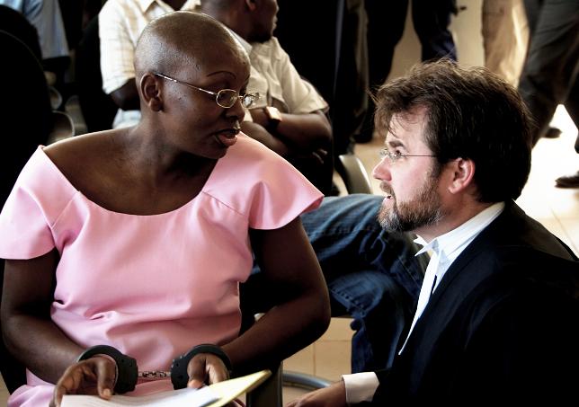 Victoire Ingabire, British atty Iain Edwards confer in court