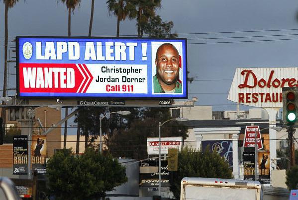 Christopher Dorner GÇÿwantedGÇÖ poster digital billboard on Santa Monica Blvd by Reed Saxon, AP