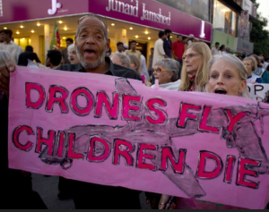 Drones-fly-children-die-protest-march-banner-Black-man, Have we sold our souls by turning a blind eye to Obama's drones?, National News & Views