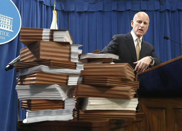Gov. Jerry Brown points to prison reports, declares prison overcrowding ended by Rich Pedroncelli, AP