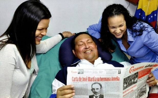 Hugo Chavez, daughters in Cuba hospital reading Granma 021413-1 by Prensa Presidencial