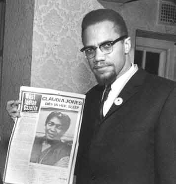 Malcolm X holding West Indian Gazette, Claudia Jones on cover 1964