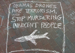 Obamas-drones-ARE-terrorism-sidewalk-chalk-sign, Have we sold our souls by turning a blind eye to Obama's drones?, National News & Views
