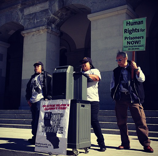 Assembly-hearing-on-SHUs-rally-Sundiata-Tate-Marilyn-Austin-Smith-reading-letter-from-Hugo-Pinell-Bato-Talamantez-022513-by-Azadeh-Zohrabi, Sacramento hearing exposes CDCR's hidden agenda, Behind Enemy Lines