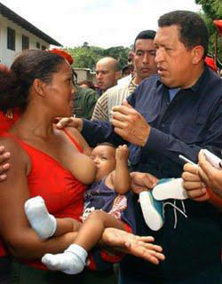 Hugo Chavez speaks with young mother nursing baby
