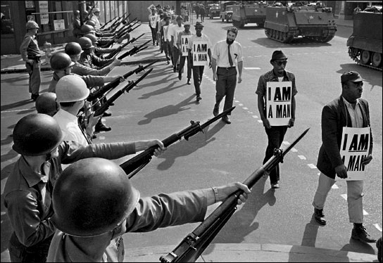 I-am-a-man-guns-tanks-Memphis-1968-by-Bettmann-CORBIS, Solidarity and solitary: When unions clash with prison reform, Behind Enemy Lines