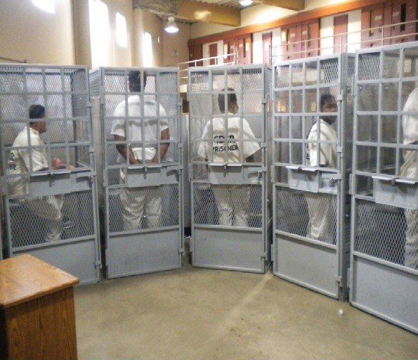 Prisoners in cages await group therapy, Mule Creek State Prison, photo from U.S. District Court briefings