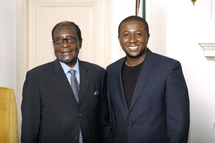 Roy Agyemang with President Robert Mugabe in his office 2008, web