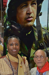Cynthia McKinney, Raul in front of Hugo Chavez mural