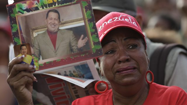 Hugo Chavez supporter cries outside Military Hosp day after he died there 030613 by AFP