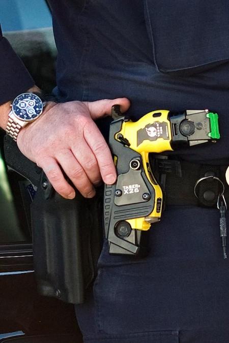 Taser in white cop's belt