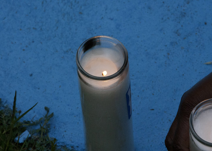 Alan Blueford 1st year memorial lit candle at nightfall 050513 by Malaika