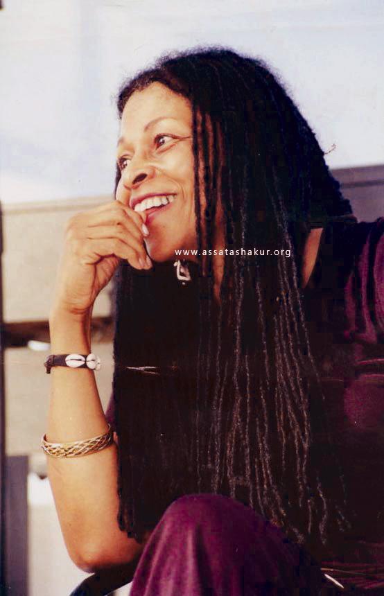 Assata Shakur, braids, smiling