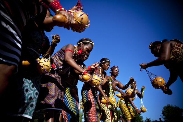 Chedepo Grebo Cultural Festival dancing with gourds at Tarlesson Farm by Carl Costas