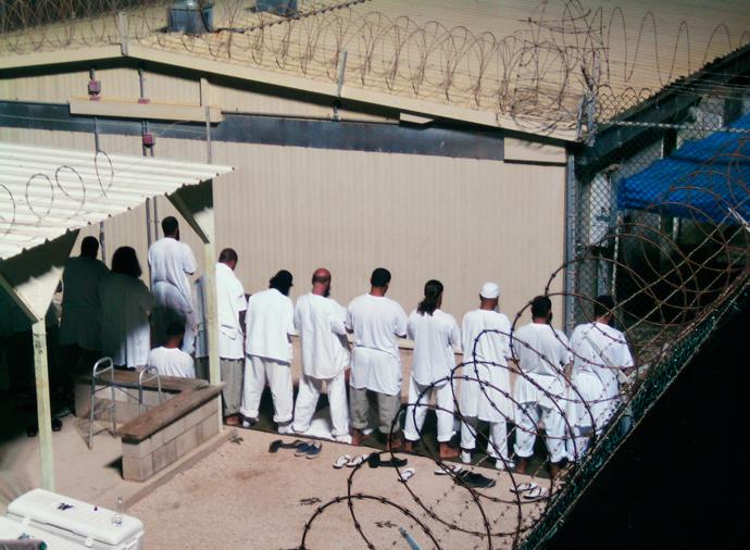 Guantanamo Bay US Naval Base detention facility prisoners early morning prayer by Deborah Genbara, Reuters