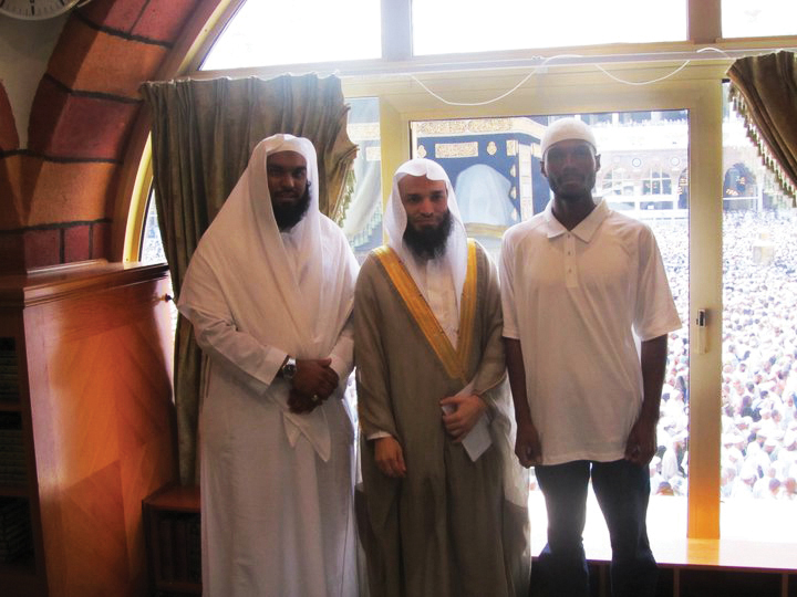 Malcolm Shabazz on Hajj, Sheikh Faisal Ghazawi, middle, Imam, Mosque Haramain; Holy Kabaa, Makkah, in background 1110
