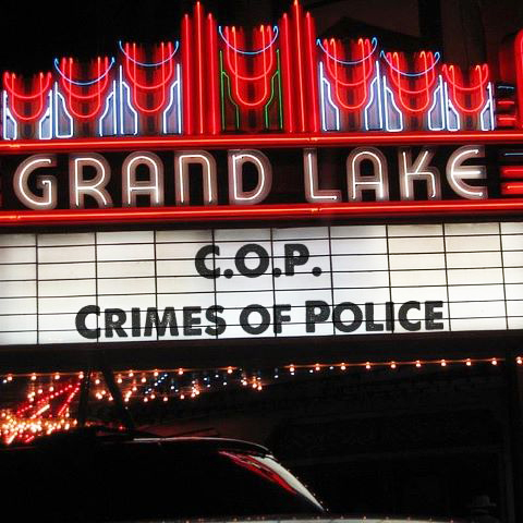 'COP Crimes of Police' Grand Lake marquee