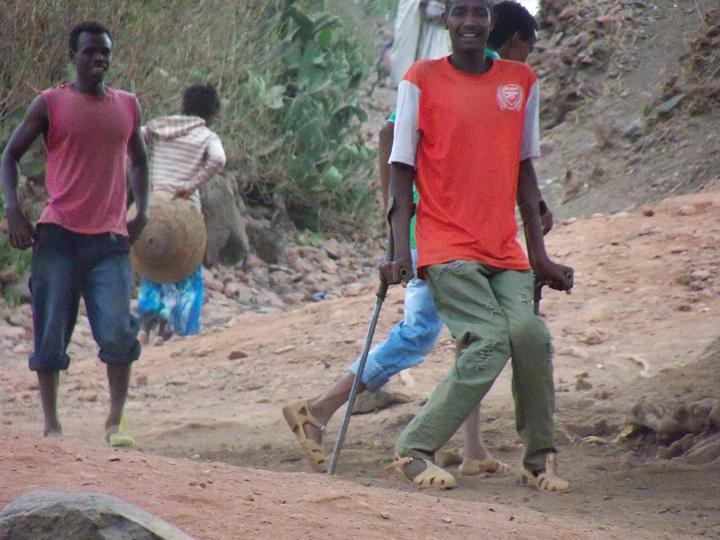 Ethiopia- soccer players, inc. one on crutches 0613 by Wanda