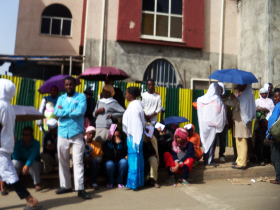 Ethiopia- waiting in line at bank for subsidized condo lottery, Addis Ababa 0613 by Wanda