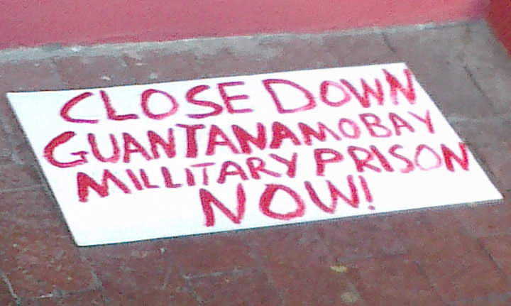 NObama Coalition Cape Town South Africa protest sign 'Close down Guantanamo Bay military prison now' 062213