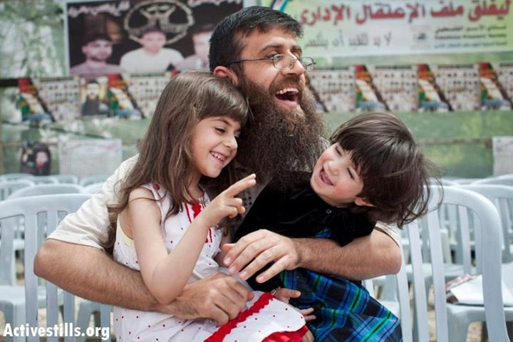 Khader Adnan reunited with his children 0212