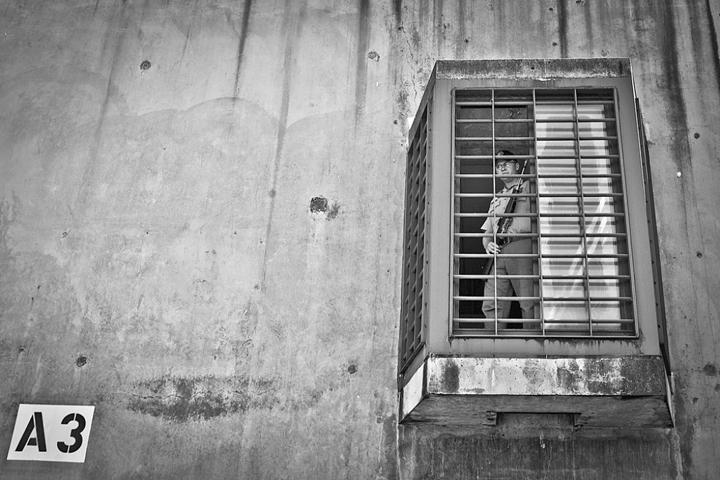 Pelican Bay prison gunner in perch by Bryant Anderson, Del Norte Triplicate