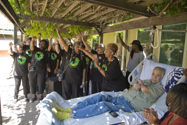Damu's farewell party Damu, Vukani Muwethu Choir fists 071413 by David Bacon