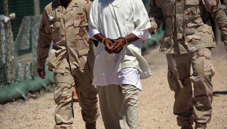 Guantanamo Black prisoner escorted by guards by CNN