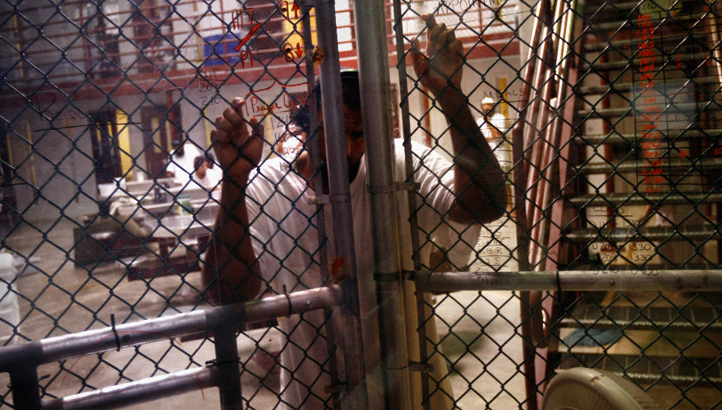 Guantanamo prisoner chain link wall by CNN
