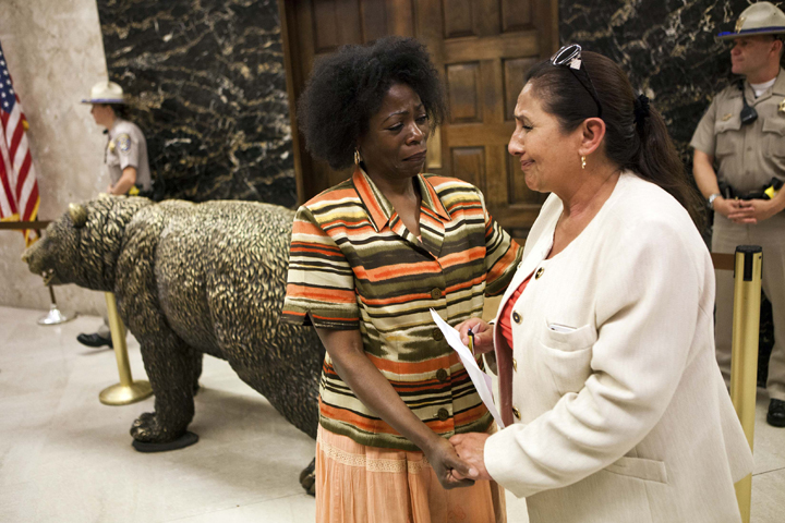Marie Levin comforts Dolores Canales after she brought 60,000 signatures protesting against indefinite solitary confinement in California prisons, to Governor Jerry Brown's office in Sacramento