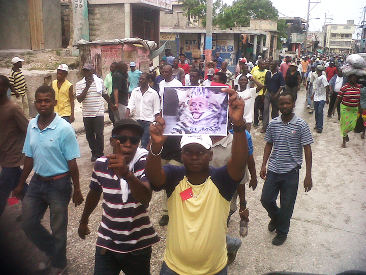 Anti-Martelly-pro-Aristide-march-Martelly-the-thieving-cat-on-21st-anniversary-of-1991-coup-against-Lavalas-093012-w, 10 steps to dictatorship: Why the grassroots movement in Haiti is taking to the streets against President Michel Martelly, World News & Views