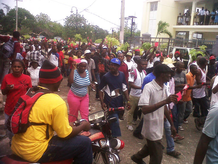 Anti-Martelly-pro-Aristide-march-red-cards-on-21st-anniversary-of-1991-coup-against-Lavalas-093012-web, 10 steps to dictatorship: Why the grassroots movement in Haiti is taking to the streets against President Michel Martelly, World News & Views
