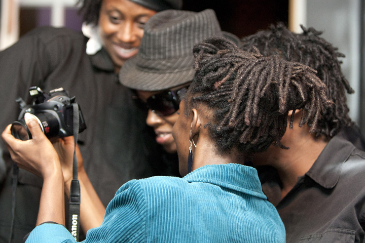 Black-Riders-doc-screening-checking-out-photos-at-One-Fam-Comy-Ctr-082413-web, To serve the people: Black Riders Liberation Party, new generation Black Panther Party for Self-Defense, Local News & Views