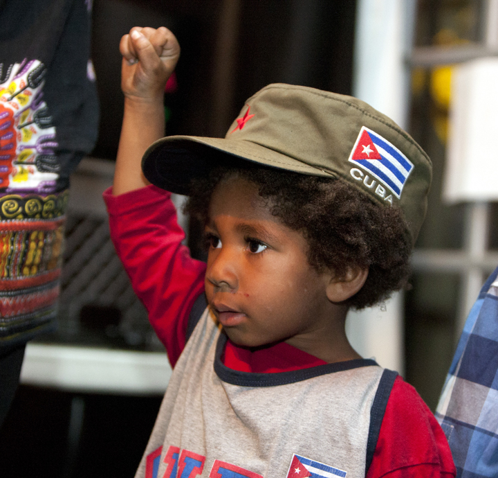 Black-Riders-doc-screening-lil-boy-watching-daddy-onstage-at-One-Fam-Comy-Ctr-082413-web, To serve the people: Black Riders Liberation Party, new generation Black Panther Party for Self-Defense, Local News & Views