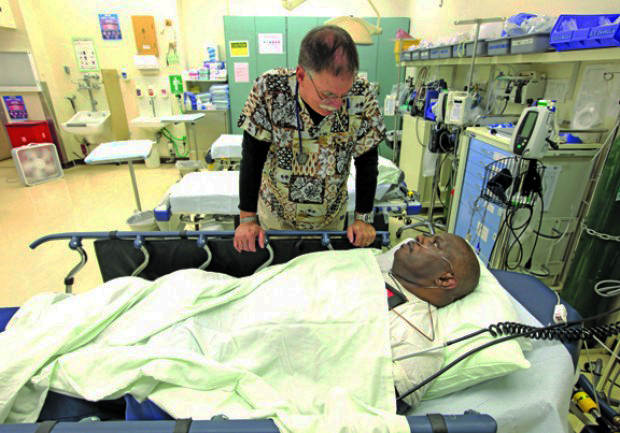 Dr. David Mathis, highest paid doctor in Calif. 2011, at $410,385, talks to Mervin Dunford CMF 1012 by Rich Pedroncelli, AP