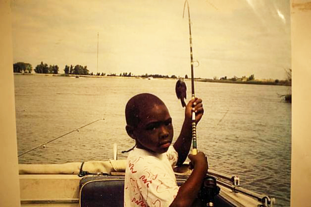 Oscar Grant III, 8, fishing