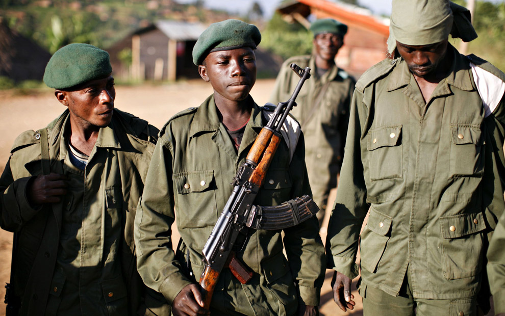 East Congo invaded US-backed forces inc. child soldier (ctr) 'Kadogo' (small one) 111708 by Finbarr O'Reilly, Reuters