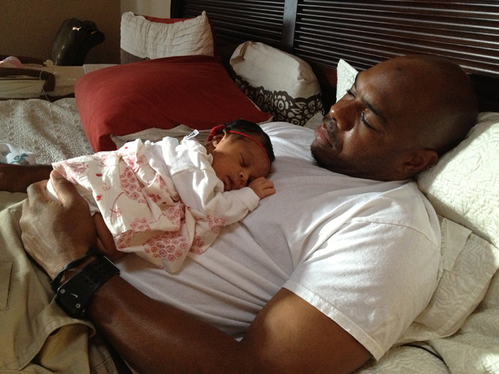 Morris Turner's son Malcolm w daughter Amaya asleep on his chest, web