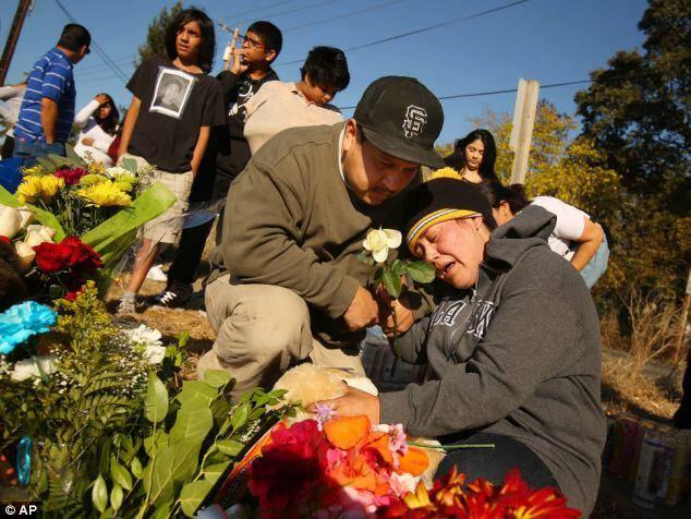 Parents Rodrigo Lopez, Sujey Annel Cruz Cazere of Andy Lopez, 13, murdered by Sonoma Cty sheriff's deputies Santa Rosa 102313 by AP