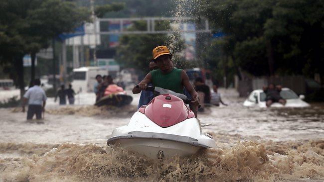 Acapulco, Mexico floods jet ski transport 091613 by Pedro Pardo, AFP