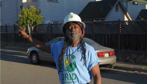 Jahahara Alkebulan-Ma'at of Grid Alternatives outreaching West Oakland by Eric K. Arnold