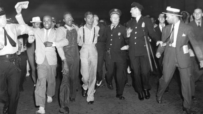Two-of-9-Scottsboro-Boys-freed-arrive-Penn-Station-NYC-Olen-Montgomery-glasses-Eugene-Williams-suspenders-072637-by-AP, Exoneration only the first step in making amends to the Scottsboro Boys, National News & Views